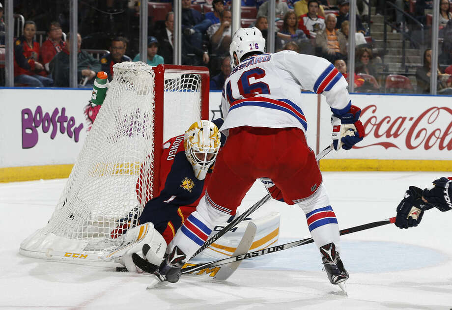 Florida Panthers goaltender Roberto Luongo (1) stops a shot by New York Rangers center Derick Brassard (16) during the second period of an NHL hockey game, Saturday, Jan. 2, 2016, in Sunrise, Fla. (AP Photo/Joel Auerbach)