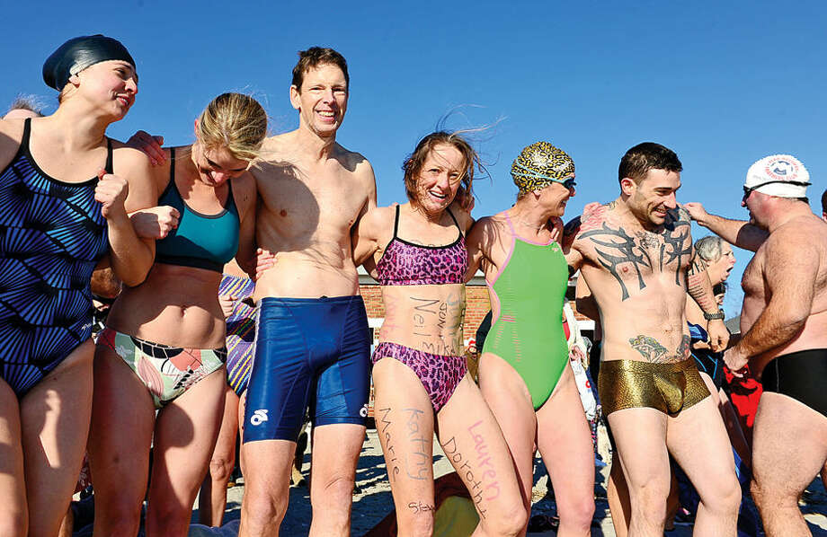 Hour photo / Erik Trautmann Participants prepare for the 11th Annual Team Mossman Polar Plunge to benefit Save the Children at Compo Beach in Westport Thursday. The second polar plunge Thursday by Westport Temple Israel raised over $70,000 for the Child Guidance Center of Mid-Fairfield County.