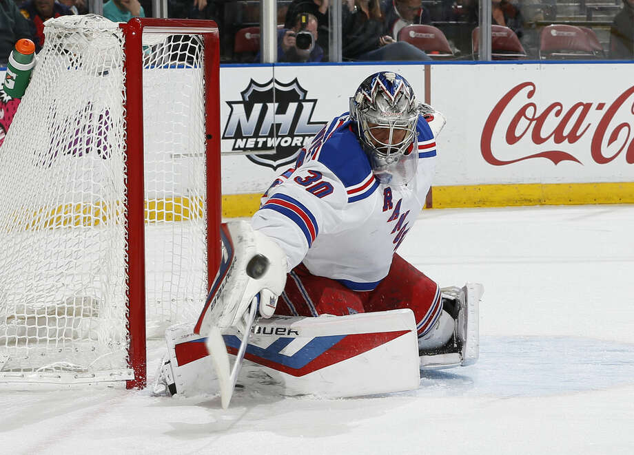 New York Rangers goaltender Henrik Lundqvist (30) defends the net against a shot by the Florida Panthers during the first period of an NHL hockey game, Saturday, Jan. 2, 2016, in Sunrise, Fla. (AP Photo/Joel Auerbach)