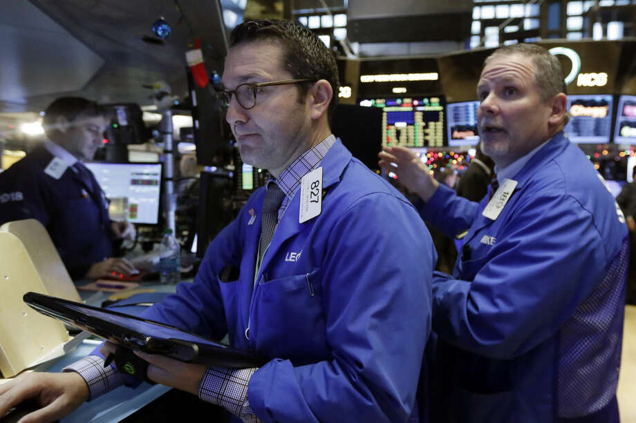 Trader Leon Montana, center, works on the floor of the New York Stock Exchange, Wednesday, Jan. 6, 2016. Stocks are opening lower as investors fret about signs of belligerence in North Korea and more weakening of China's economy. (AP Photo/Richard Drew)