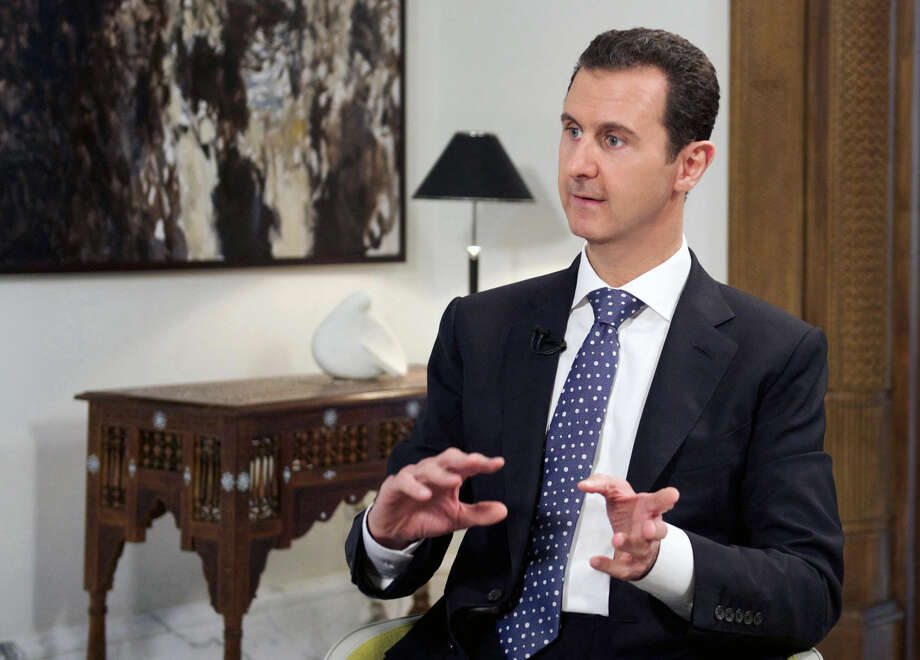In this photo released by the Syrian official news agency SANA, shows Syrian President Bashar Assad, speaks during an interview with the Spanish news agency EFE, in Damascus, Syria, Friday, Dec. 11, 2015. The Obama administration's best-case scenario for political transition in Syria does not foresee Assad stepping down as the country's leader before March 2017, outlasting Barack Obama's presidency by at least two months, according to a document obtained by The Associated Press. (SANA via AP)