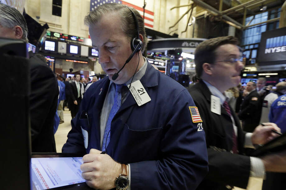 Trader James Doherty, left, works on the floor of the New York Stock Exchange, Wednesday, Jan. 6, 2016. Stocks are opening lower as investors fret about signs of belligerence in North Korea and more weakening of China's economy. (AP Photo/Richard Drew)