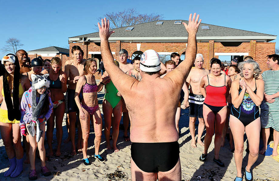 Hour photo / Erik Trautmann Robin Myers organizes the 11th Annual Team Mossman Polar Plunge at Compo Beach in Westport Thursday to benefit Save the Children. The second polar plunge Thursday by Westport Temple Israel raised over $70,000 for the Child Guidance Center of Mid-Fairfield County.