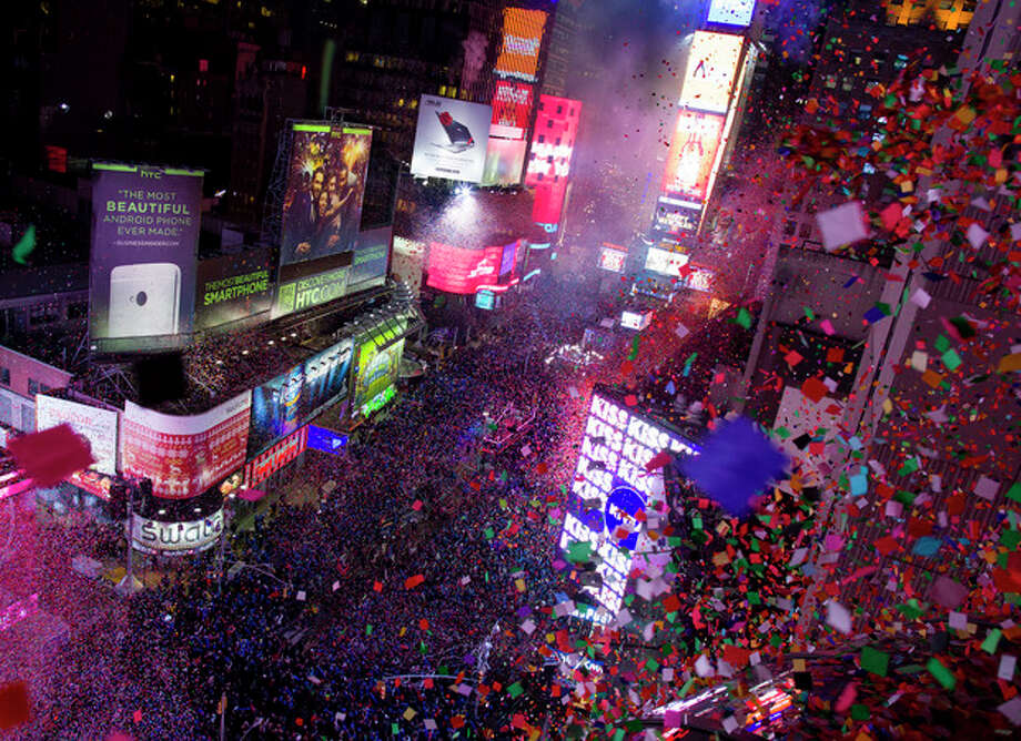 Confetti flies over Tines Square in New York Wednesday, Jan. 1, 2014 as the new year is celebrated. (AP Photo/Craig Ruttle) / FR61802 AP