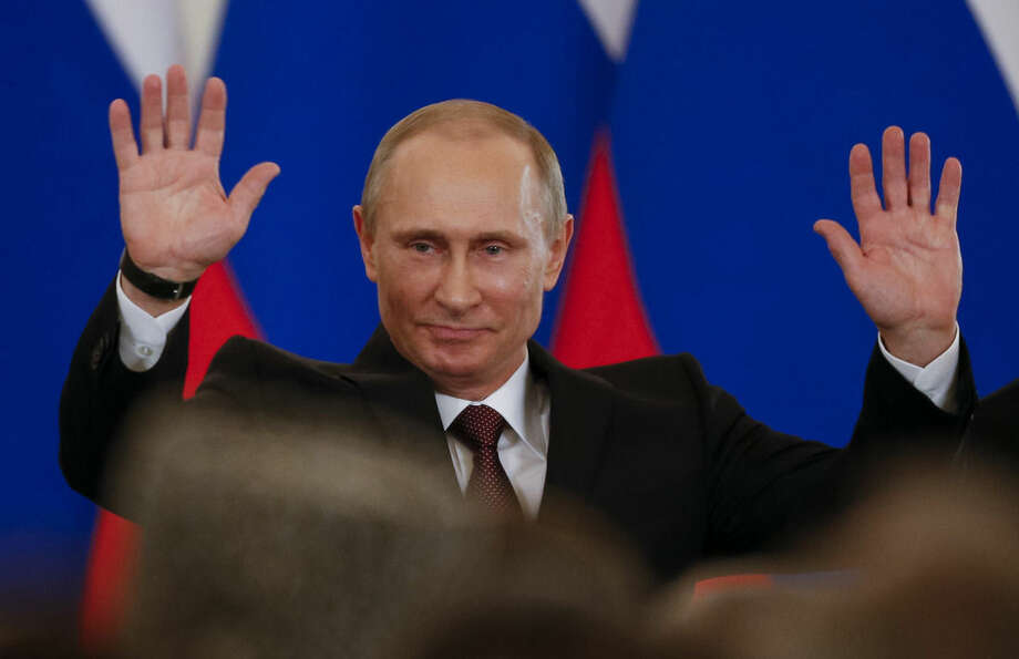 FILE - In this Tuesday, March 18, 2014 file photo, Russian President Vladimir Putin gestures after signing a treaty to incorporate Crimea into Russia in the Kremlin in Moscow, Russia. The chances of that appear unpromising. In his New Year's Eve televised message to the nation, Putin hailed the annexation of Crimea as a historic achievement and the rightful return of the peninsula's people to the bosom of Russia. (AP Photo/Alexander Zemlianichenko, file)
