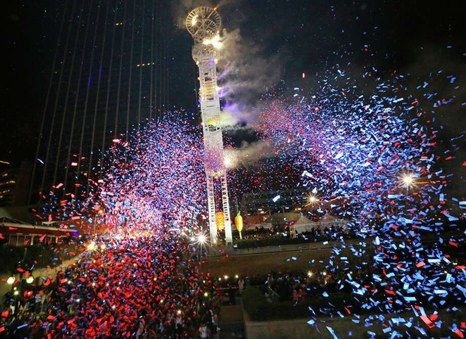 Confetti fills the air as 2014 arrives with the Peach Drop at Underground Atlanta early New Year's Day, Wednesday, Jan. 1, 2014, in Atlanta. (AP Photo/Atlanta Journal-Constitution, Curtis Compton) GWINNETT OUT MARIETTA OUT LOCAL TV OUT (WXIA, WGCL, FOX 5) / Atlanta Journal-Constitution