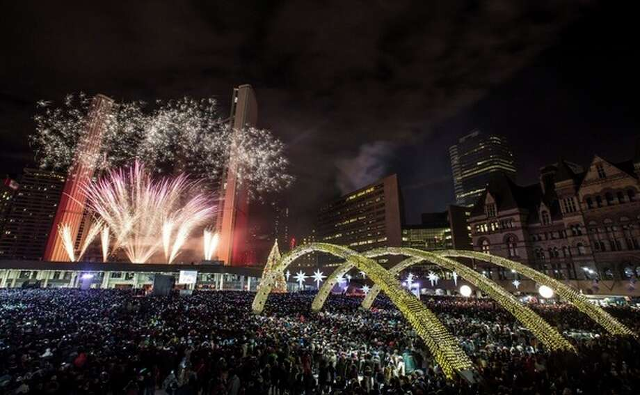 Fireworks explode during Year's Eve celebrations at Nathan Phillips Square in Toronto, Wednesday, Jan. 1, 2014. (AP Photo/The Canadian Press, Mark Blinch) / The Canadian Press