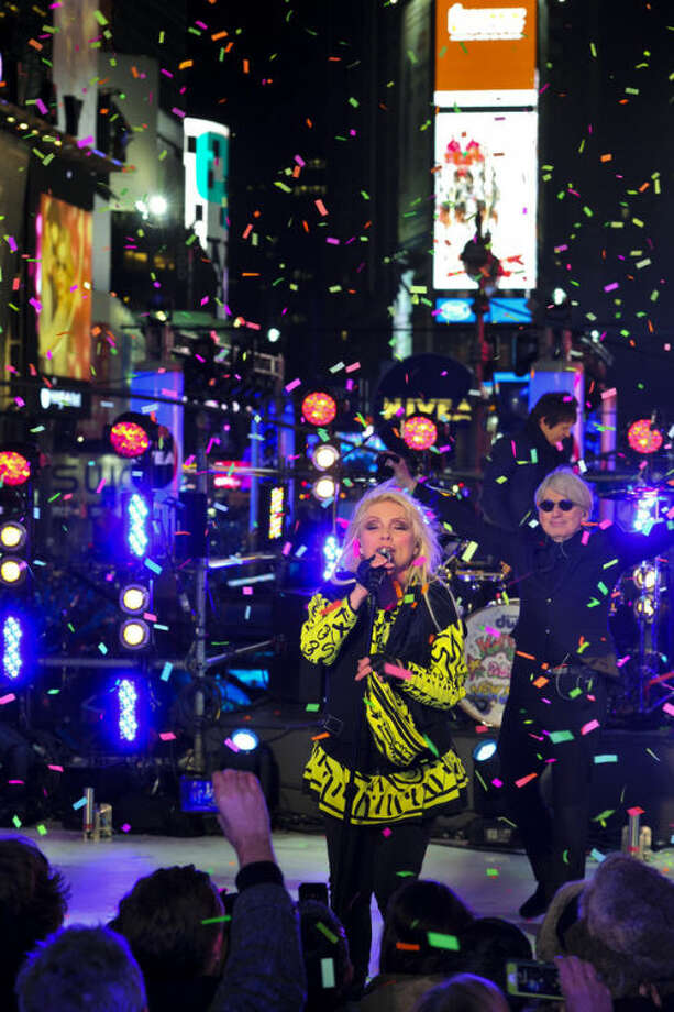 Deborah Harry from the band Blondie performs in Times Square during New Year's Eve celebrations on Tuesday, Dec. 31, 2013 in New York. (Photo by Charles Sykes/Invision/AP)
