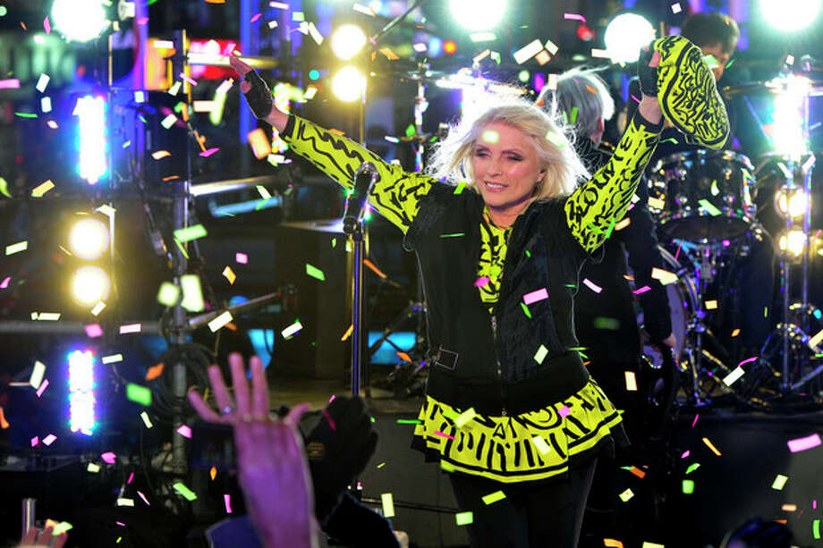 Deborah Harry from the band Blondie performs in Times Square during New Year's Eve celebrations on Tuesday, Dec. 31, 2013 in New York. (Photo by Charles Sykes/Invision/AP) / Invision