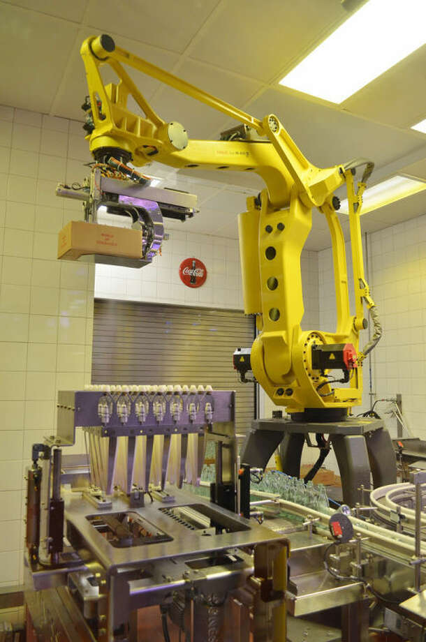 Tom Maglieri, courtesy FlickrManufacturing facilities that do not depend on human labor to get work done may have some energy saving benefits but are certainly not beneficial overall considering the impact widespread adoption would have on needed jobs. Pictured: a Robotic arm loading Coca Cola bottles into boxes and loading the boxes onto an assembly line.