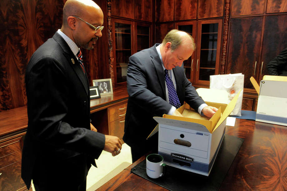 "New Detroit Mayor Mike Duggan unpacks boxes with Melvin ""Butch"" Hollowell after taking the oath of office, New Years Day, Wednesday, Jan. 1, 2014, at the Coleman Young Municipal Center in Detroit. (AP Photo/The Detroit News, Steve Perez) / The Detroit News"