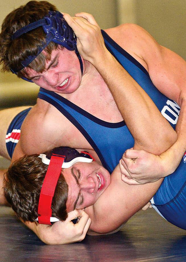Hour photo / Erik Trautmann Wilton High School wrestler Jared Gladstein takes on Brien McMahon's Eli Felber during their 182 lb bout Wednesday night in Wilton.