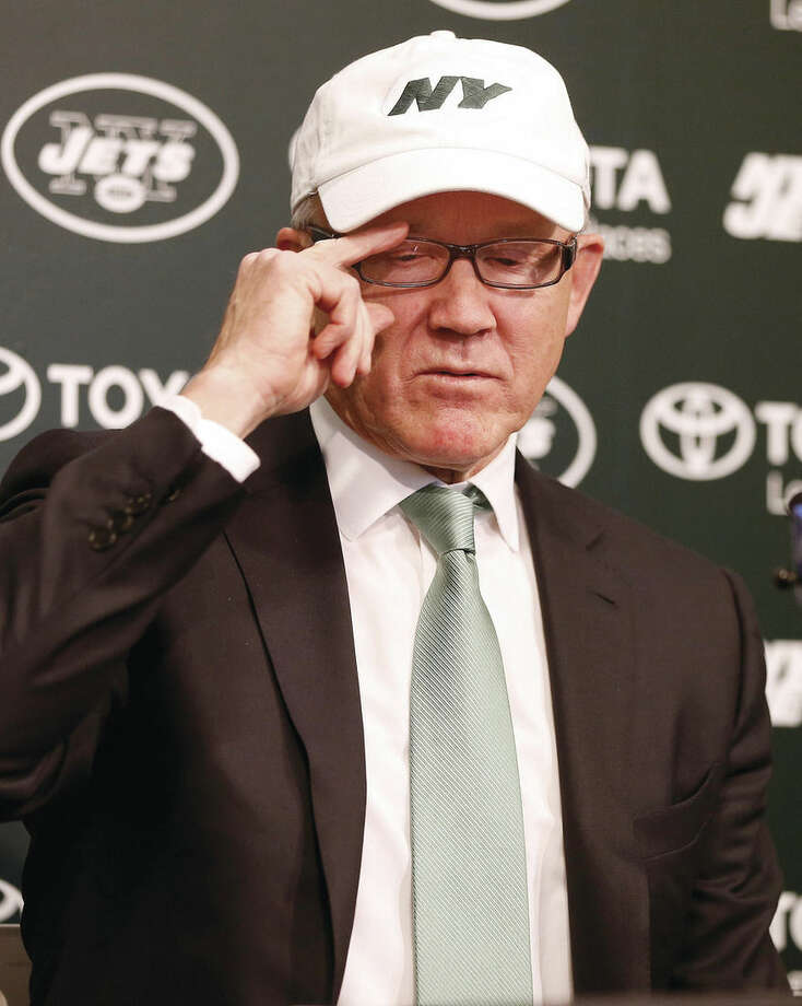 New York Jets owner Woody Johnson announces the firing of head coach Rex Ryan and general manager John Idzik at the team's practice facility in Florham Park, N.J., Monday, Dec. 29, 2014. (AP Photo/Rich Schultz)