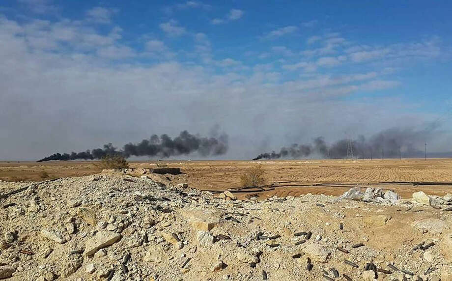 Smoke rises following a U.S.-led coalition airstrike on Islamic State group positions, outside Haditha, 240 kilometers (150 miles) northwest of Baghdad, Iraq, Tuesday, Jan. 5, 2016. Islamic State had captured Ramadi in May, in one of its biggest advances since the U.S.-led coalition began striking the group in 2014. Recapturing the city, which is the provincial capital of Anbar, provided a major morale boost for Iraqi forces. (AP Photo)