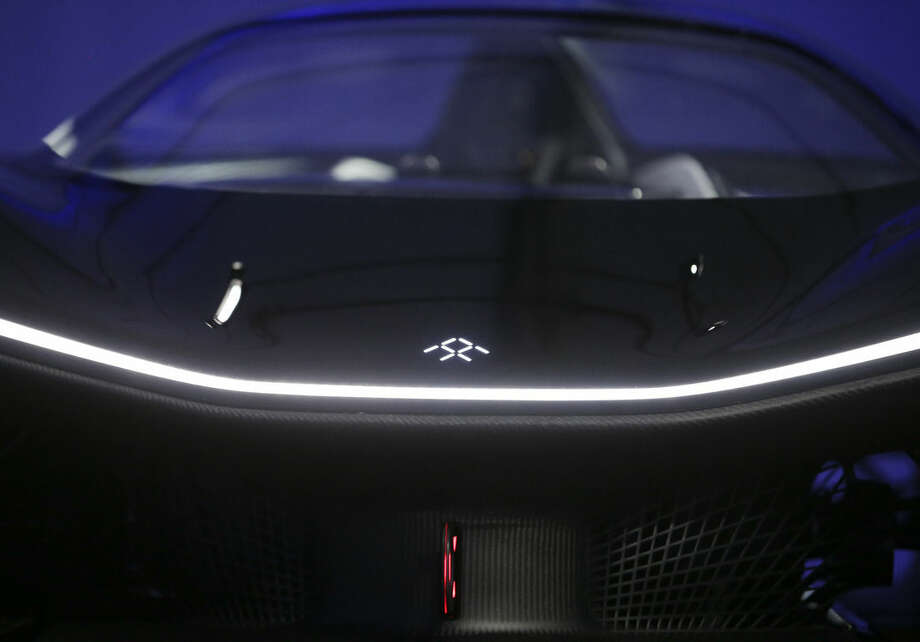 The front hood of the FFZero1 by Faraday Future is displayed at CES Unveiled, a media preview event for CES International Monday, Jan. 4, 2016, in Las Vegas. The high-performance electric concept car was unveiled during a news conference by Faraday Future. (AP Photo/Gregory Bull)