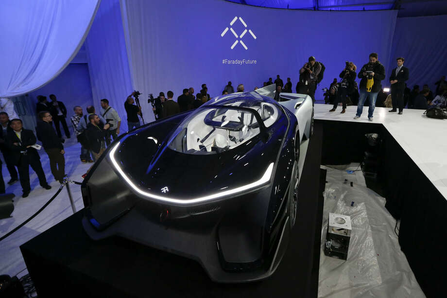 The FFZero1 by Faraday Future is displayed at CES Unveiled, a media preview event for CES International Monday, Jan. 4, 2016, in Las Vegas. The high-performance electric concept car was unveiled during a news conference by Faraday Future. (AP Photo/Gregory Bull)