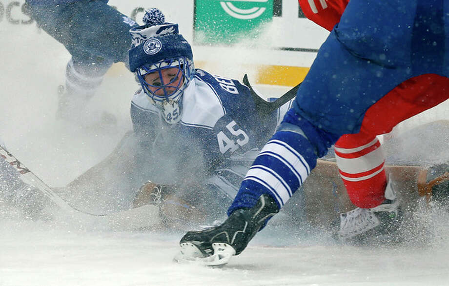 Toronto Maple Leafs goalie Jonathan Bernier (45) stops a shot on goal during the second period of the Winter Classic outdoor NHL hockey game against the Detroit Red Wings at Michigan Stadium in Ann Arbor, Mich., Wednesday, Jan. 1, 2014. (AP Photo/Paul Sancya) / AP