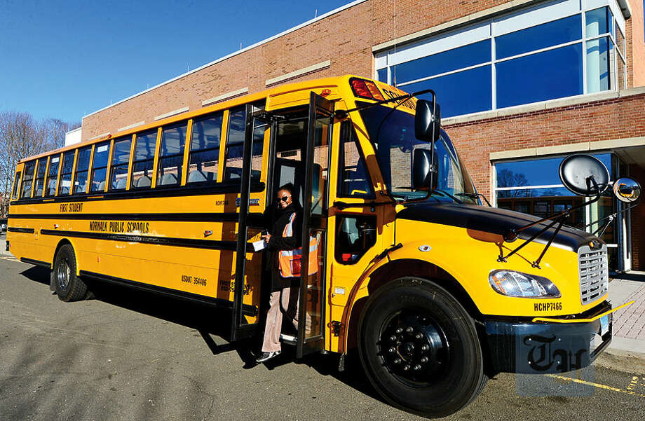 Hour photo / Erik Trautmann First Student Safety Manager Benita Hargett exits one of the new Thomas Built SAF-T-LINER® C2 school buses that go into service this week.