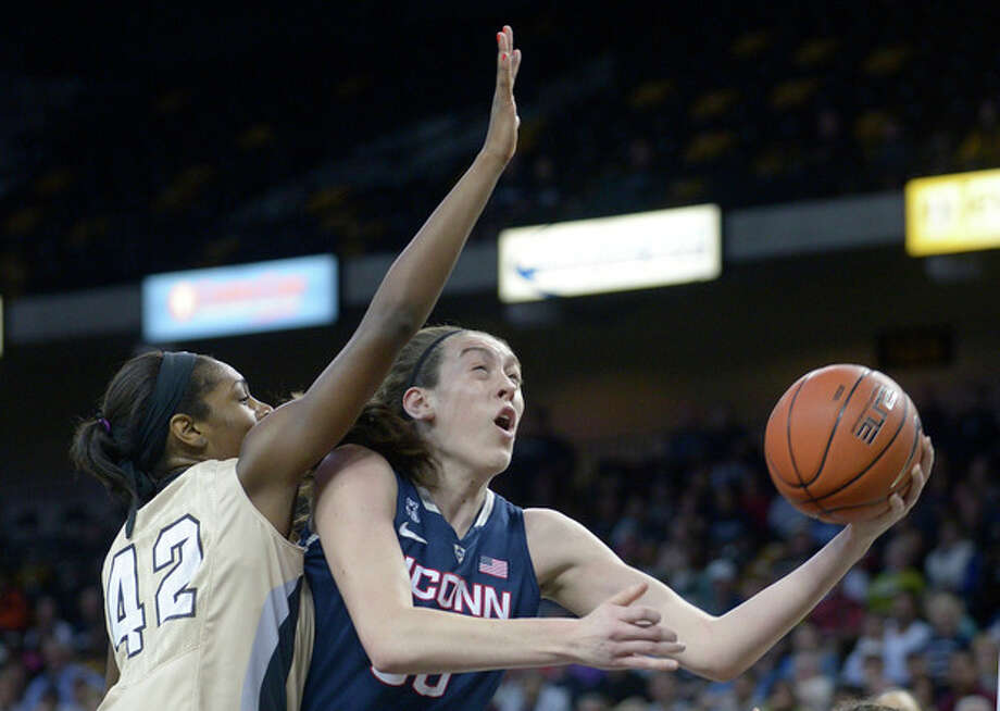 Connecticut forward Breanna Stewart, right, goes up for a shot in front of Central Florida forward Stephanie Taylor (42) during the first half of an NCAA college basketball game in Orlando, Fla., Wednesday, Jan. 1, 2014. (AP Photo/Phelan M. Ebenhack) / FR121174 AP