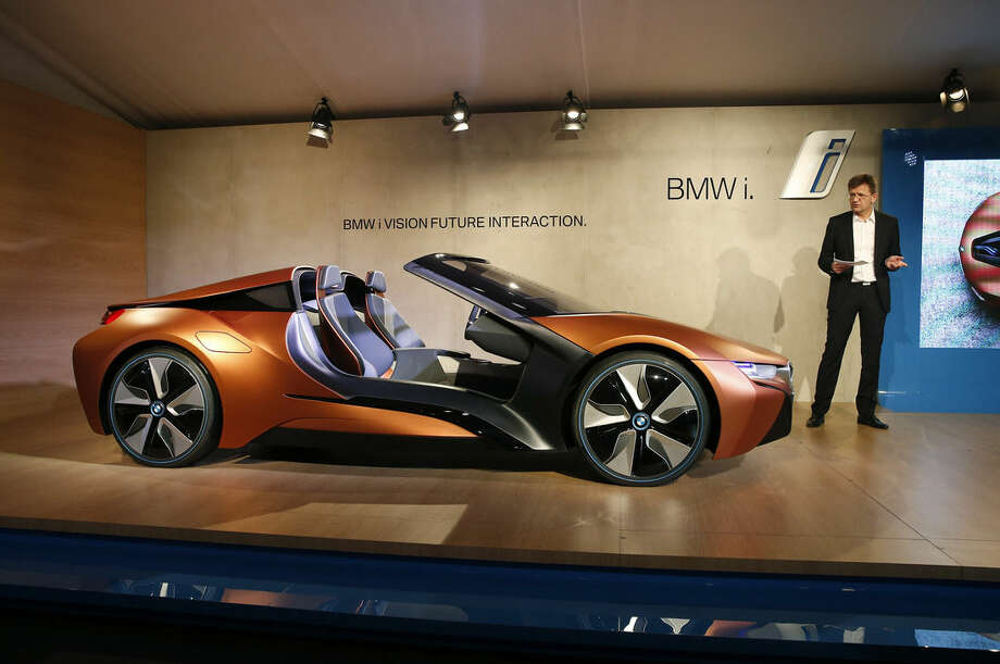BMW board member Klaus Froehlich introduces the BMW i Vision Future Interaction concept car during a news conference at CES Press Day at CES International, Tuesday, Jan. 5, 2016, in Las Vegas. (AP Photo/John Locher)