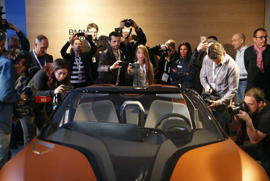 People take pictures of the BMW i Vision Future Interaction concept car during a news conference at CES Press Day at CES International, Tuesday, Jan. 5, 2016, in Las Vegas. (AP Photo/John Locher)