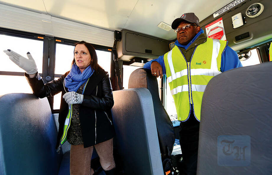 Hour photo / Erik Trautmann First Student location manager Theresa Taylor and driver Kevin Brown talk about the new school buses that will be put into service this week including the Thomas Built SAF-T-LINER® C2.