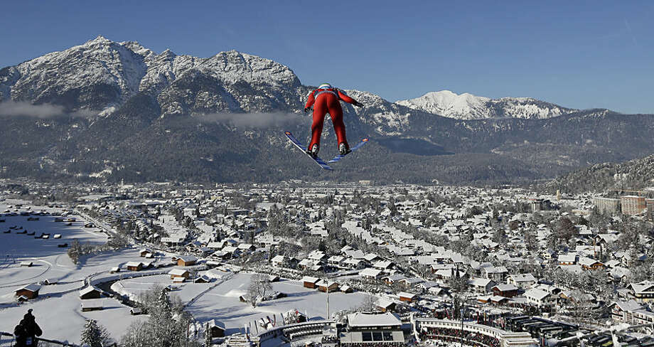Norway's AndersJacobsen soars during the trial jump at the second stage of the four hills ski jumping tournament in Garmisch-Partenkirchen, Germany, on Thursday, Jan. 1, 2015. (AP Photo/Matthias Schrader)