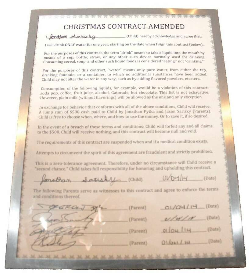 This photo, taken Dec. 24, 2014, in Livingston, Mont., shows the contract Jonathan Sarisky and his parents signed, which details the terms of Jon's commitment to a year without indulging in a single sugary drink. (AP Photo/Livingston Enterprise, Hunter D'Antuono)