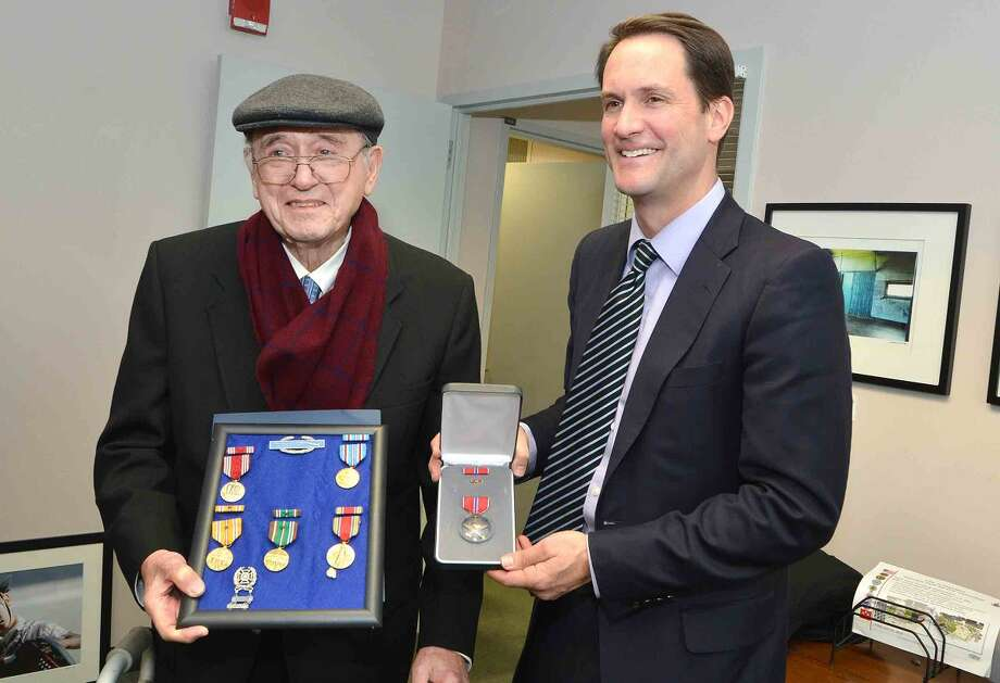 Congressman Jim Himes presents Anthony Zaccagnino with a long overdue Bronze Star and other medals for his service with the U.S. Army during World War II.