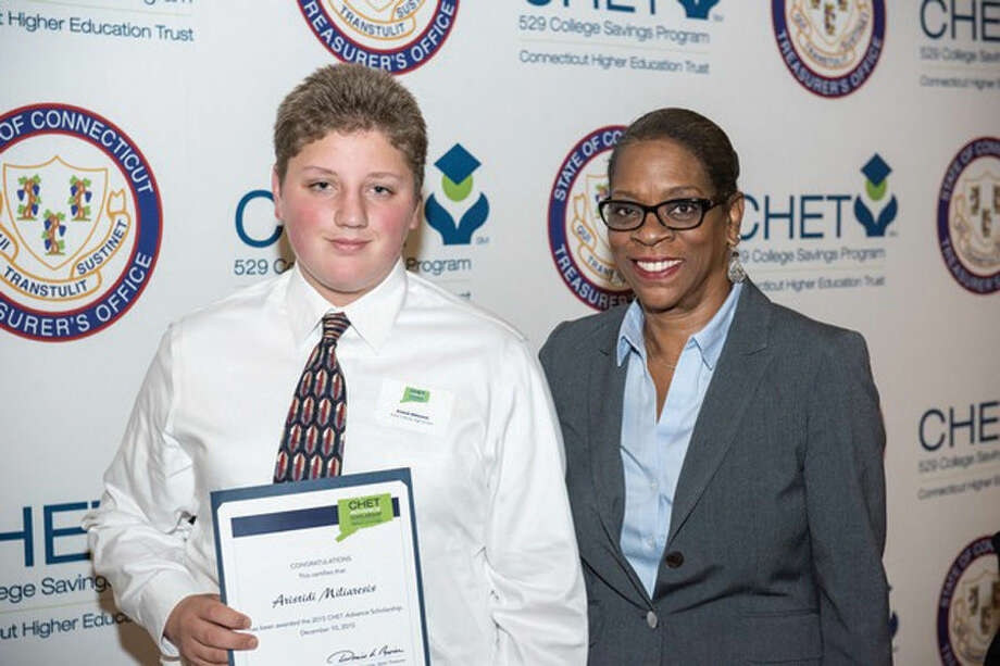 Aristidi Miliaresis, left, and Catherine Massa, right, are among five Stamford high school students recently awarded the 2015 Connecticut Higher Education Trust (CHET) Advance Scholarship. The two are pictured here with Denise Nappier, state treasurer and trustee of the Connecticut Higher Education Trust.
