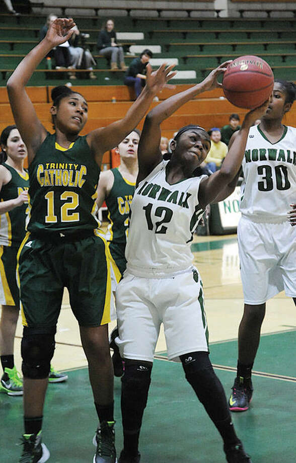 #12 Norwalk Asiah Knight #12 Trinity Kayla Cheatam. Hour photo/Matthew Vinci