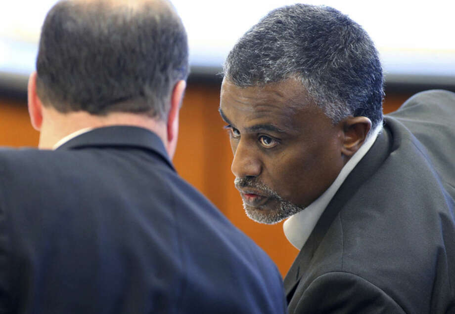 FILE - In this Dec. 29, 2015 file photo, Fanuel Gebreyes, right, father of Aden Hailu, talks to his attorney David O'Mara during a hearing in Washoe County District Court in Reno, Nev. Hailu, a 20-year-old woman at the center of an end-of-life court battle over her treatment at a Reno hospital, died Monday, Jan. 4, 2016, while still on life support, her family's lawyer said Tuesday. Hailu died at Saint Mary's Regional Medical Center, where she never awoke from anesthesia after surgery April 1, said O'Mara, the attorney representing Hailu's father and family. (Cathleen Allison/Las Vegas Review-Journal via AP, Pool, File)