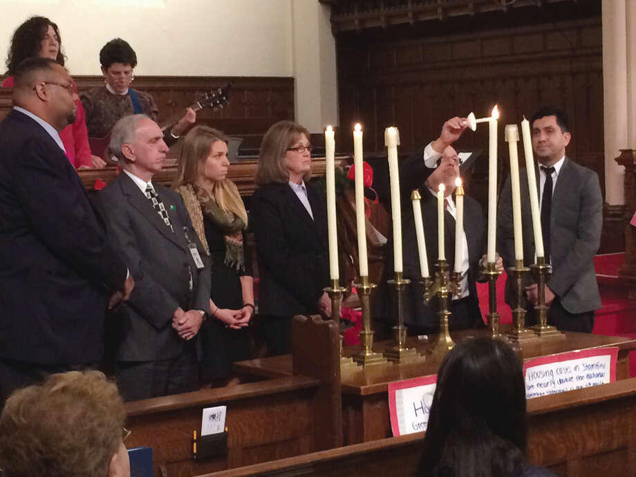 Community leaders gather at First Congregational Church of Stamford on National Homeless Persons Memorial Day Dec. 22 to light candles in remembrance of nine people who died homeless in the city this past year.