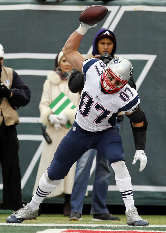FILE - In this Dec. 21, 2014 file photo, New England Patriots tight end Rob Gronkowski (87) spikes the football after scoring a touchdown during the first half of an NFL football game against the New York Jets, in East Rutherford, N.J. Gronkowski was a unanimous selected to the 2014 Associated Press NFL All-Pro team announced Friday, Jan 2, 2015. (AP Photo/Julio Cortez)