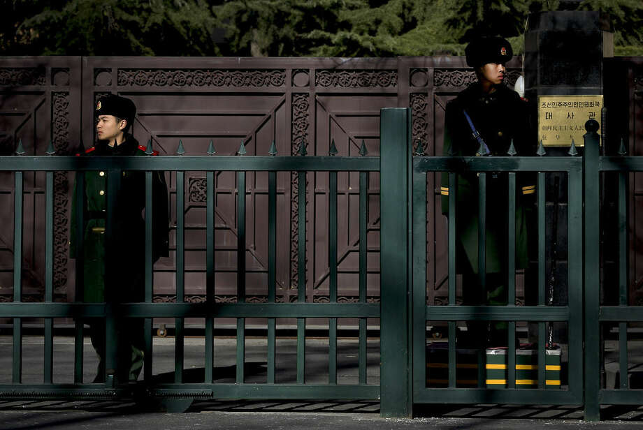 Chinese paramilitary policemen stand guard outside the North Korean Embassy in Beijing, Wednesday, Jan. 6, 2016. North Korea said it conducted a powerful hydrogen bomb test Wednesday, a defiant and surprising move that, if confirmed, would be a huge jump in Pyongyang's quest to improve its still-limited nuclear arsenal. (AP Photo/Andy Wong)