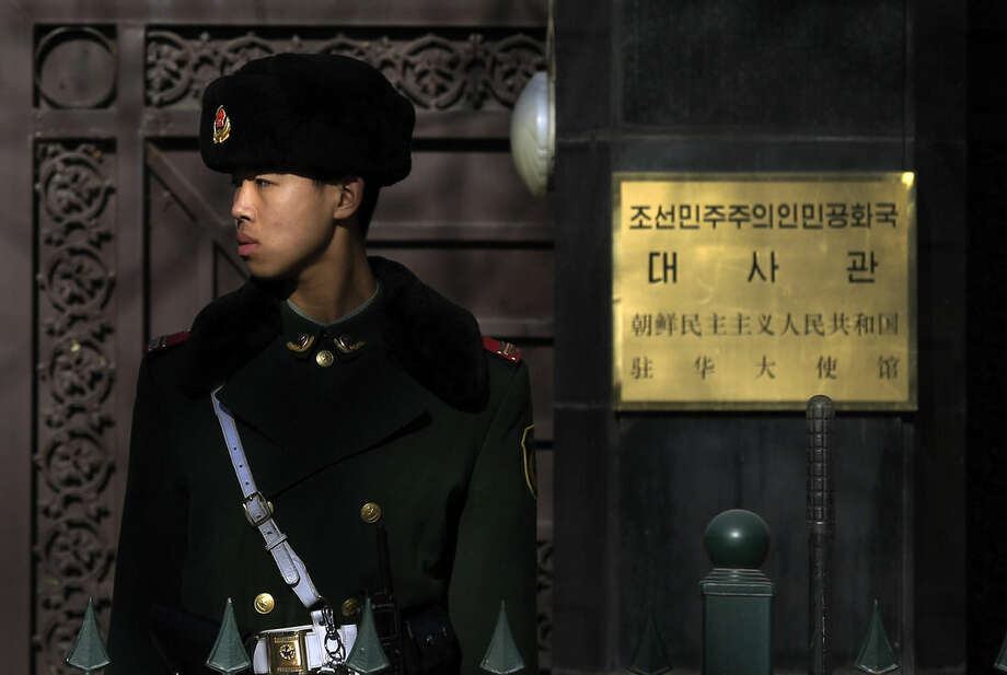A Chinese paramilitary policeman stands guard outside the North Korean Embassy in Beijing, Wednesday, Jan. 6, 2016. North Korea said it conducted a powerful hydrogen bomb test Wednesday, a defiant and surprising move that, if confirmed, would be a huge jump in Pyongyang's quest to improve its still-limited nuclear arsenal. (AP Photo/Andy Wong)