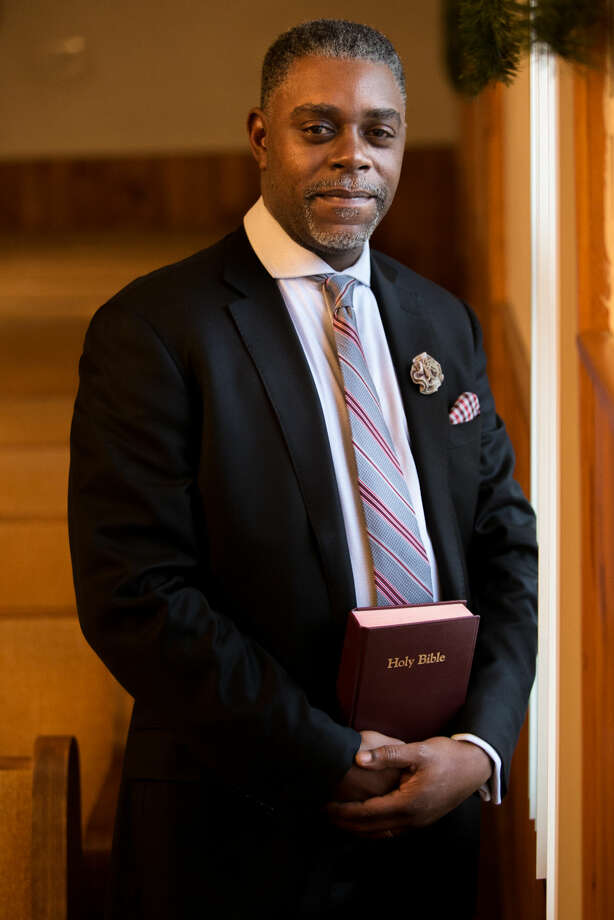 Hour photo/Chris Palermo. Rev. DuBose is preparing for his upcoming Martin Luther King weekend sermon.