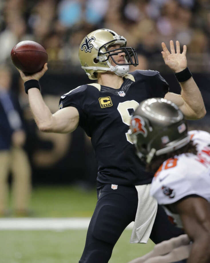 New Orleans Saints quarterback Drew Brees (9) throws a 76-yard touchdown pass in the first half of an NFL football game against the Tampa Bay Buccaneers, Sunday, Dec. 29, 2013, in New Orleans. (AP Photo/Bill Haber)
