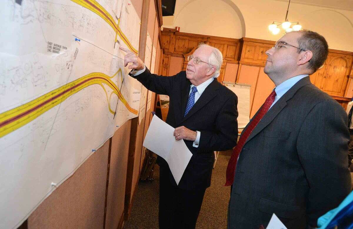 Hour Photo/Alex von Kleydorff Norwalk resident and attorney Frank Murphy has some questions for Don Costello, Project Manager with AECOM a consulting firm during a Public Informational meeting at City Hall about construction projects along !95 in Norwalk and Westport