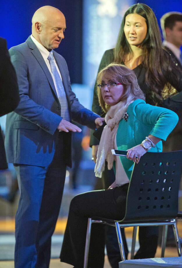Former Rep. Gabby Giffords, D-Ariz., right, and her husband Mark Kelly, left, arrive to participate in President Barack Obama's televised town hall at George Mason University in Fairfax, Va., Thursday, Jan. 7, 2016. Obama's proposals to tighten gun controls rules may not accomplish his goal of keeping guns out of the hands of would-be criminals and those who aren't legally allowed to buy a weapon. In short, that's because the conditions he is changing by executive action are murkier than he made them out to be. (AP Photo/Pablo Martinez Monsivais)