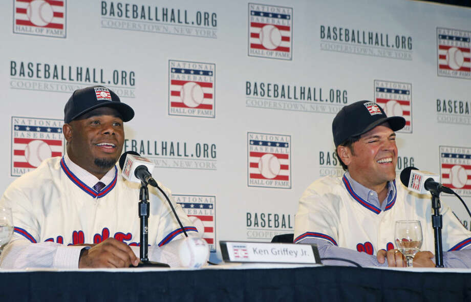 Ken Griffey Jr., left, speaks and Mike Piazza reacts at a press conference announcing their election to baseball's Hall of Fame, Thursday, Jan. 7, 2016, in New York. Both men will be inducted into the Hall of Fame this summer. (AP Photo/Kathy Willens)