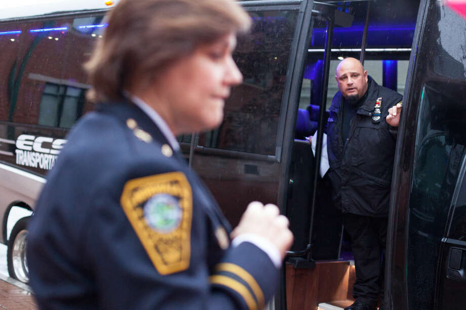 Hour photo/Chris Palermo. Norwalk Police Officers board the bus to attend the funeral of slain New York Police Department Officer Wenjian Liu Sunday morning. Officer Liu was fatally shot along with his partner Officer Rafael Ramos on Dec. 20.