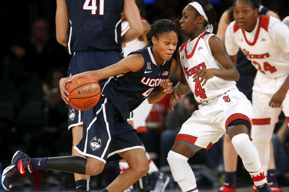 Connecticut's Moriah Jefferson, left, drives against St. John's Aaliyah Lewis, right, during the first half of an NCAA college basketball game Sunday, Jan. 4, 2015, in New York. (AP Photo/Jason DeCrow)