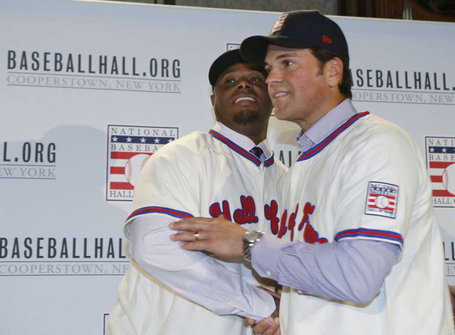 Ken Griffey Jr., left, and Mike Piazza embrace at a press conference announcing their election to baseball's Hall of Fame, Thursday, Jan. 7, 2016, in New York. Both men will be inducted into the Hall of Fame this summer. (AP Photo/Kathy Willens)