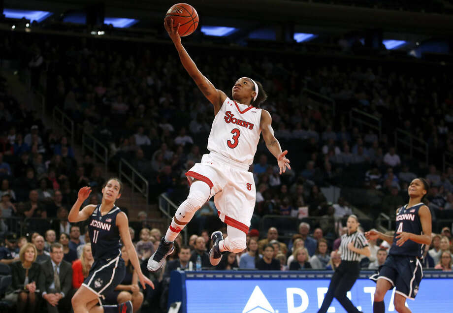St. John's Aliyyah Handford (3) scores on a fast break against Connecticut during the first half of an NCAA college basketball game Sunday, Jan. 4, 2015, in New York. (AP Photo/Jason DeCrow)