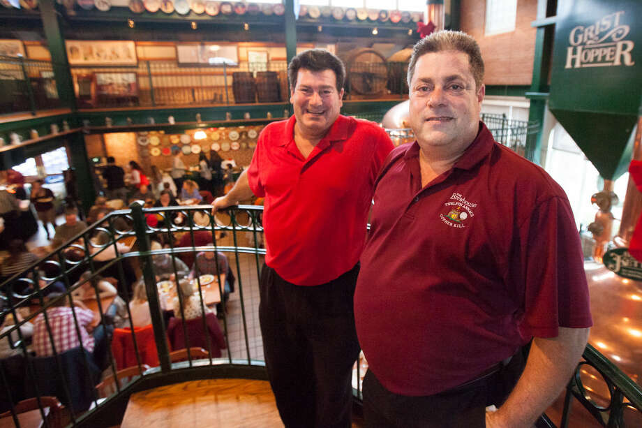 Hour photo/Chris Palermo. Lou and Bob Montanari, owners of SoNo Brewhouse enjoy the last brunch before shutting their doors forever Sunday afternoon.