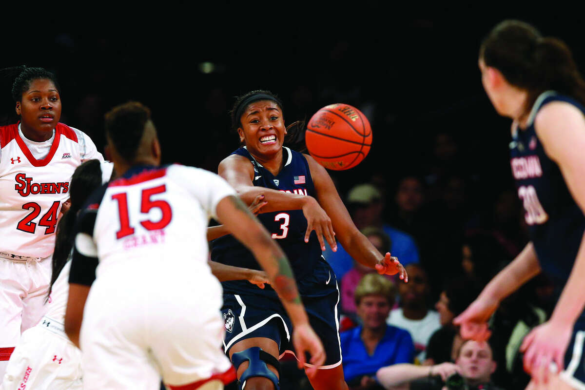 Connecticut's Morgan Tuck (3) passes against St. John's during the second half of an NCAA college basketball game Sunday, Jan. 4, 2015, in New York. Connecticut beat St. John's 70-54. (AP Photo/Jason DeCrow)
