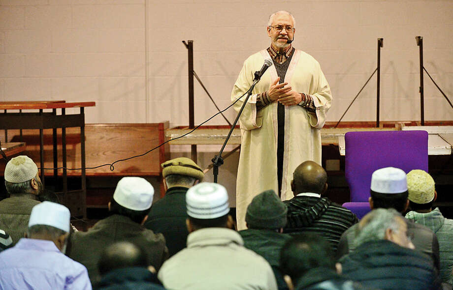 Hour photo / Erik Trautmann Imam Azzeim Mahmoud addresses members of the new Al Madany mosque on Park St in Norwalk Friday.