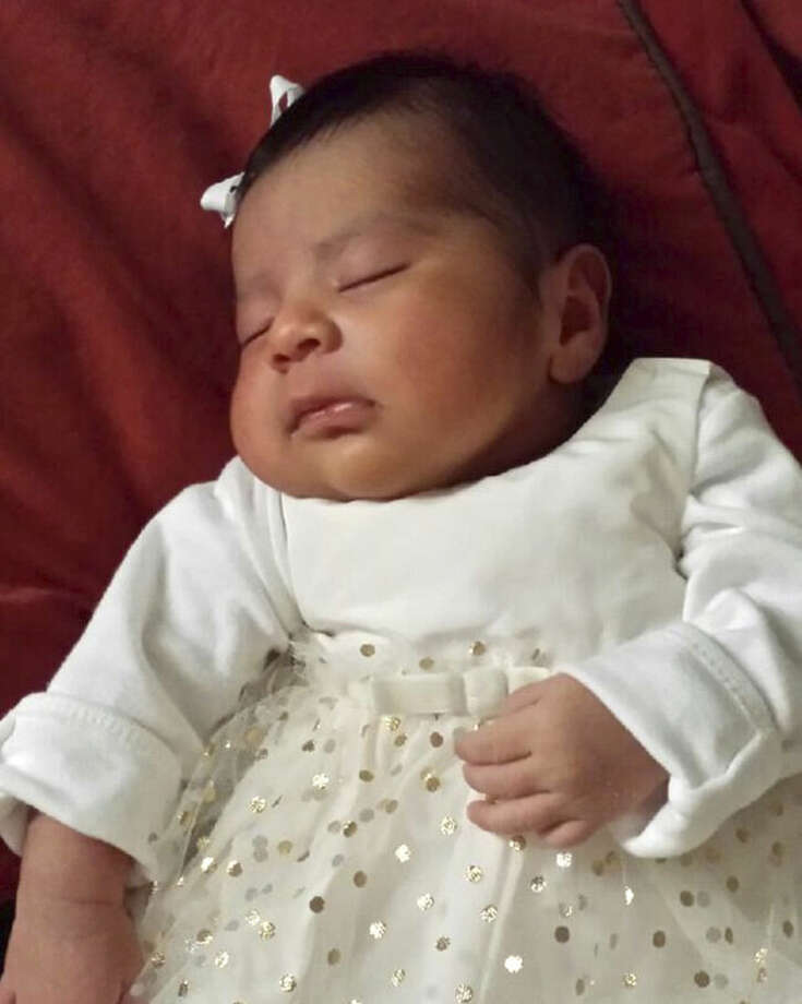 Missing baby Eliza Delacruz is seen in an undated photo provided by the Long Beach Police Department. Long Beach police say 3-week-old Eliza Delacruz is missing from a home where the baby's mother, father and uncle were found shot. Long Beach police spokeswoman Marlene Arrona says officers went to the residence Saturday evening, Jan. 3, 2015, after receiving a call about the shooting. Officers found two brothers and the baby's mother with gunshot wounds. Arrona says one of the brothers was the father of the baby. The adult male suspect and the 10-pound baby girl Eliza Delacruz are the focus of an urgent police search. (AP Photo/ Long Beach Police Department)