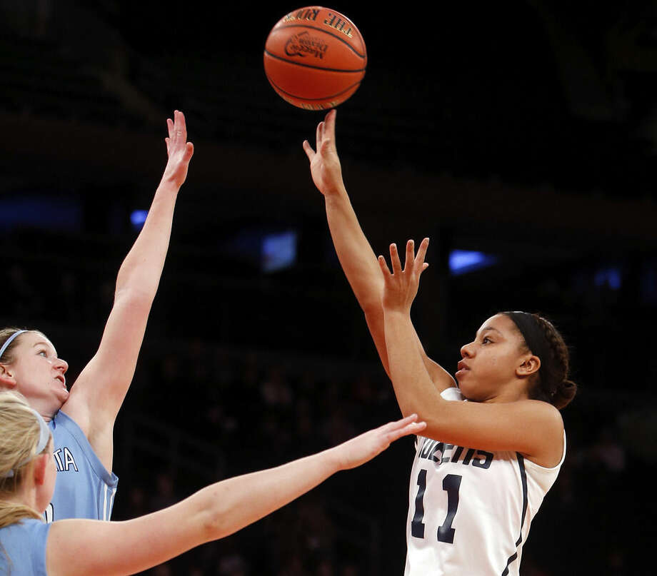 Queens' Madison Rowland (11) shoots against Immaculata's Meghan Gallagher, left, during the first half of an NCAA college basketball game Sunday, Jan. 4, 2015, in New York. (AP Photo/Jason DeCrow)
